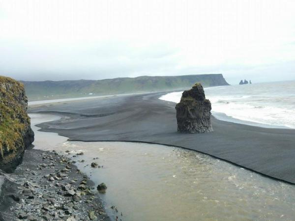 Icelandic Coast with Black Volcanic Sand and Volcanic Stack