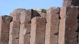 Columnar Basalt. Red Basaltic Prisms. Giant's Causeway, N. Ireland.  2007. missofotz